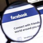 Ostersund, Sweden - April 13, 2014: Facebook website under a mag